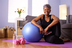 Older woman smiling and doing yoga