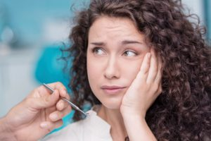 woman with a toothache called the emergency dentist Plano loves