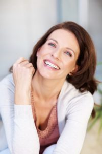 laughing woman with a beautiful smile thanks to CEREC in Plano