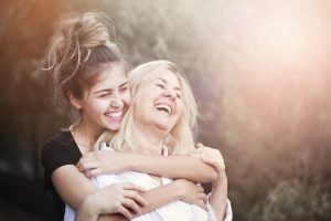 How can your dentist in Plano improve your mother's smile?